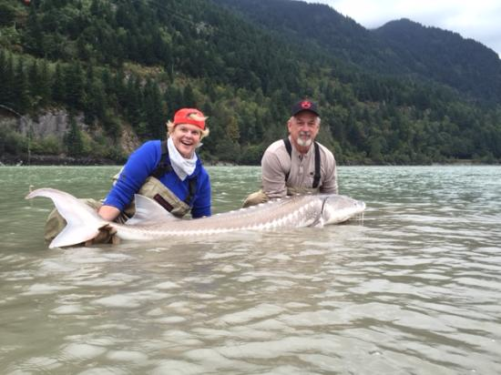 Me and our guide with a 55 picture of fraser river for My fishing advisor