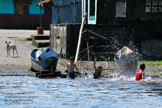 Naujan Lake National Park: Children enjoying the lake's clean waters at Brgy Pasi dock