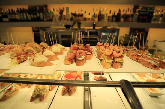 Bilbao Berria: Pinchos displayed on the bar counter~