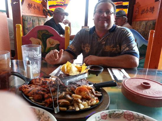 Fiesta Mexicana Family Restaurant: Under new management a very different feel. The fajitas for two served by a smiling Lupe. Thanks