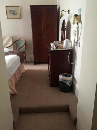 Marchwiel, UK: step to the bedroom area of the room