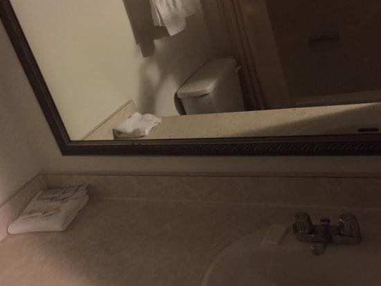 Crisfield Budget Inn: 1. Dirty bathroom light 2. The out of service poil 3-5. Room 6. Tub 7. Ripped chair 8. Dirty bli