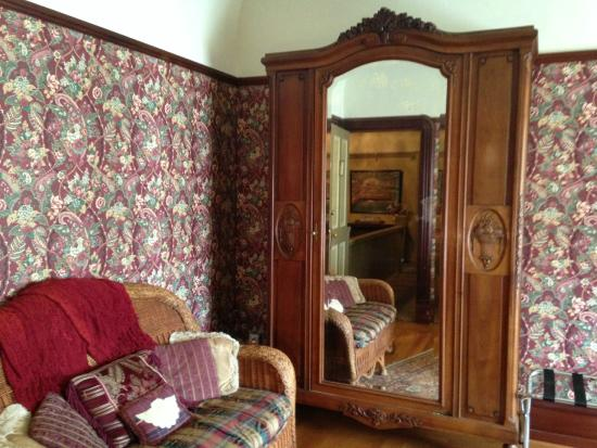 The Daly Inn: The Armoire and wicker loveseat in the room.