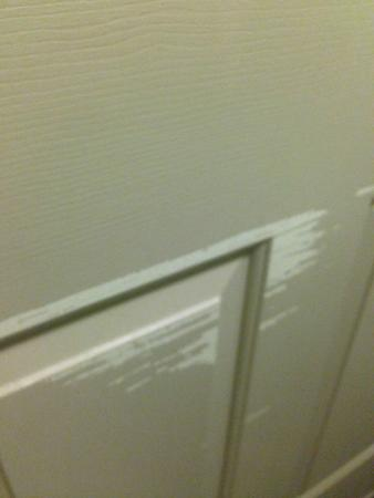 Sleep Inn at Bush River Road: paint chipped off bathroom door