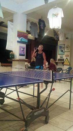 Surf Club Sports Bar: Mike the Owner chugging a beer before a ping pong challenge