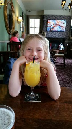 The Red Lion: A very happy girl with her lovely whitebait lunch and a drink as big as her head!