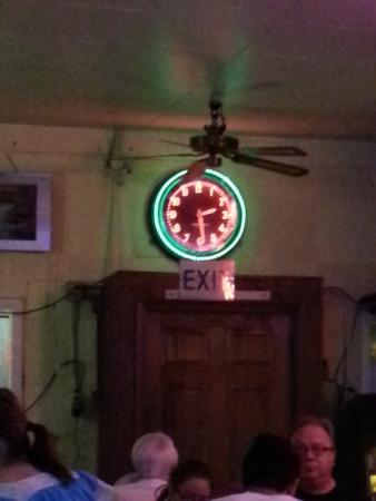 301 Cafe: the old neon clock above the entry