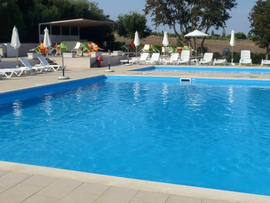 Area piscina picture of fournia village kyllini for Piscina hotel olympia