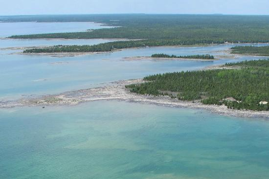 Acres on the Lake Bed and Breakfast: Aerial view of our shoreline.  You can see our house