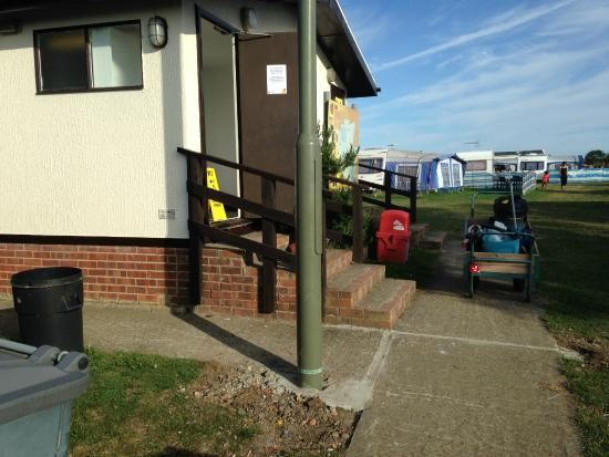 Sheerness Holiday Park: Outward opening doors on top of stairs that are left shut and locked to non campers(unless clean