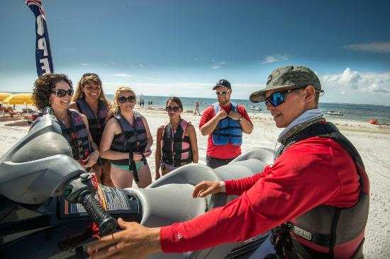 Holiday Water Sports: Our tour guide, Arlin, giving an instruction for the Dolphin Adventure Tour