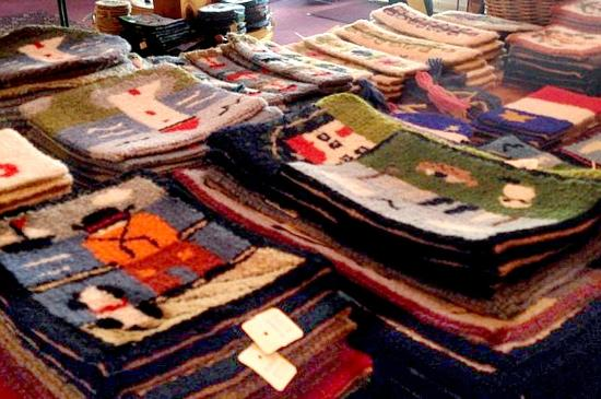 Flora's Gift Shop: Wonderful selection of Cheticamp hooked rugs!
