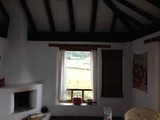 Casa Mojanda: A view of the stove, and a small window to the west