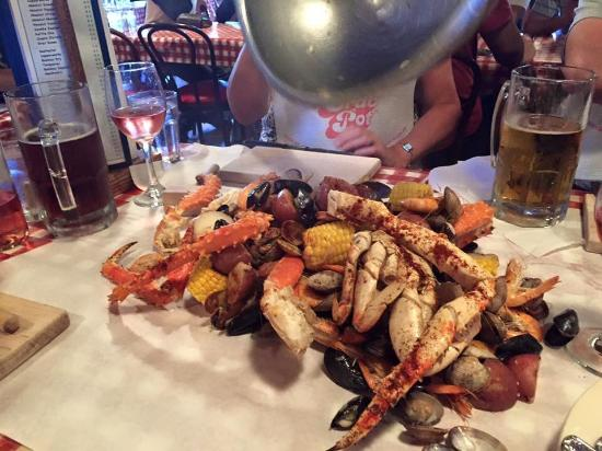 The Crab Pot Seafood Restaurant: The Pour Of The Seafood Onto The Table