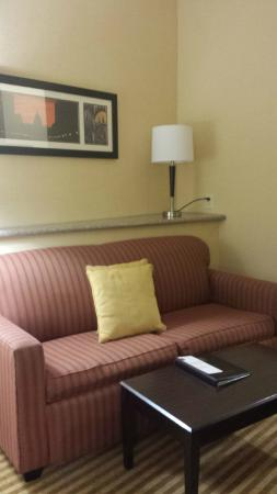 Comfort Suites : Sofa, a sitting area beside the bed