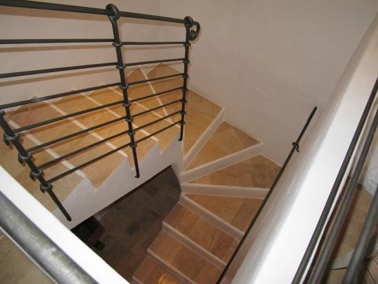The stairs, plenty of hand rails and not steep  - Picture of