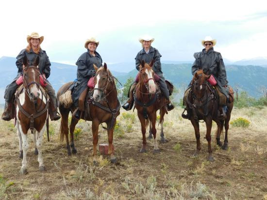 Mc Coy, CO: The horses come with rain slickers!