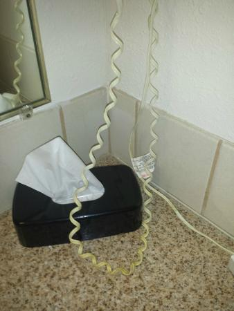 AmericInn Hotel & Conference Center La Crosse - Riverfront: Hair dryer cord - why didn't they just toss this?