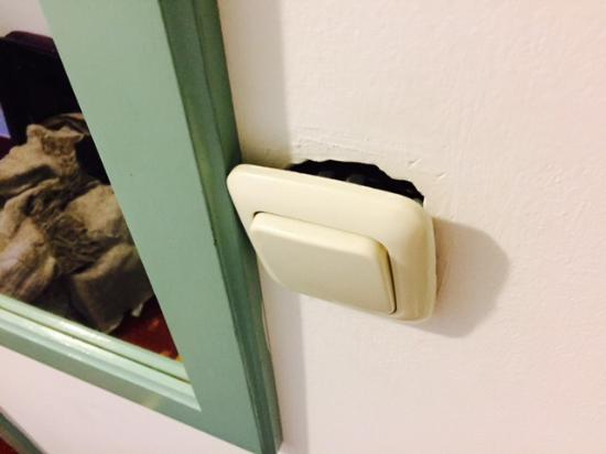 Hotel Villa Nico : Pretty sure that's not safe for a bathroom light switch!