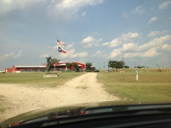 "Burton, TX: Main drive 3.  The red ""barn"" is the tasting room."