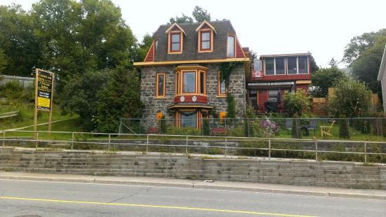 Crews on INN: the 3 level field stone home built in 1891 on the Main St. of Huntsville Ont.