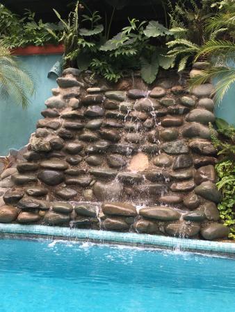 Fun waterfall going into the pool!!