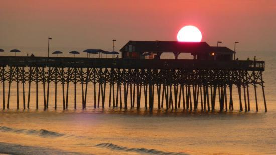 Sunrise over the pier picture of the pier at garden city beach garden city beach tripadvisor for Things to do in garden city sc