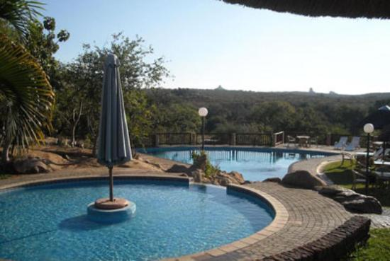 Ekuthuleni : The beautiful swimming pool with slides for the kids and stunning views.