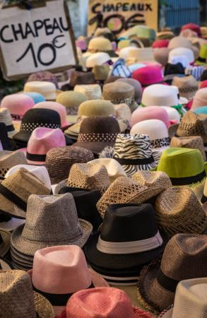 Marche Provencal: Hats on sale in three different booths.