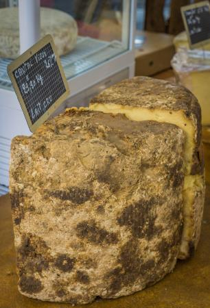 Marche Provencal: I was told this was the oldest cheese in the market that day. I didn't buy it, I did smell it! :