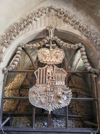 Ossuary / The Cemetery Church: Герб