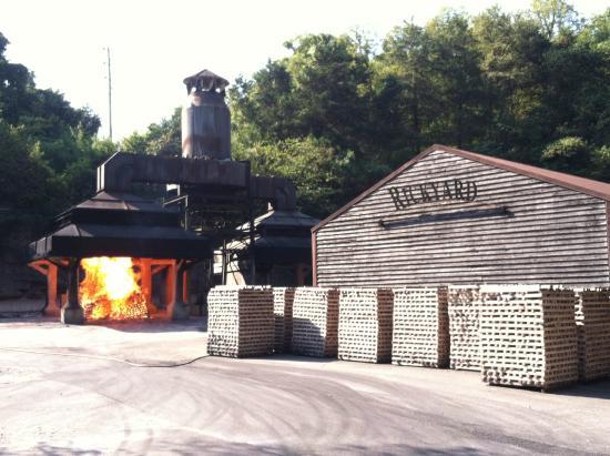 Jack Daniel's Distillery: Jack Daniel's rick yard - burning sugar maple to make charcoal