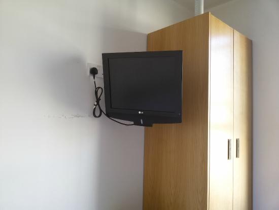 Hyde Park Executive Apartments: Televisão no quarto