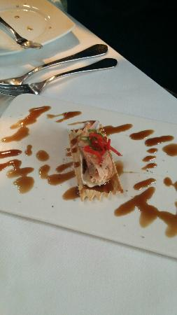 Bridgewater Bistro: smoked salmon, bree cheese, honey glaze on a thin cracker (garnished with a sweet pepper like ta