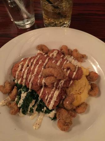 Catfish and crawfish tails over grits