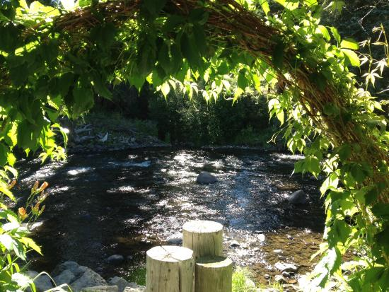 South Fork, CO: view of river right in the backyard of the B&B through a beautiful seating area arbor