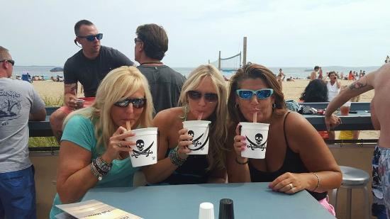 Voodoo Buckets with beach in the background