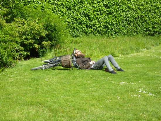 Schloss Rosenborg: Local bicyclist having forty winks by the herbaceous border in Kongens Have