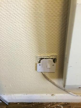 Pontin's Camber Sands Centre: plug for heater in lounge