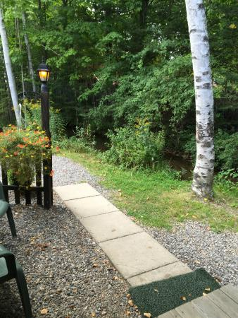 Country Bumpkins Campground and Cabins: Walkway to Trailer #1 from Parking