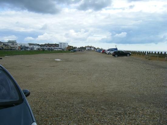 rough car park with tat shops at the end - Picture of