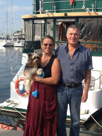 Making Waves Boatel: Our Hosts, Diane and Captain Ted with a visiting canine friend, Apollo.