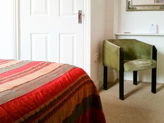 Wedgewood House: Bed, bathroom door & comfy chair in Room 2