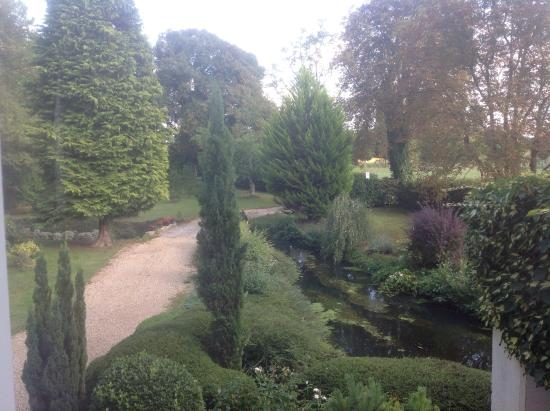 Le Moulin Page : View of front garden with stream