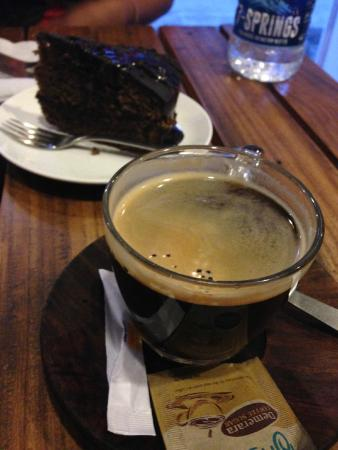Open Hand Espresso Bar & Bistro : black coffee and chocolate cake