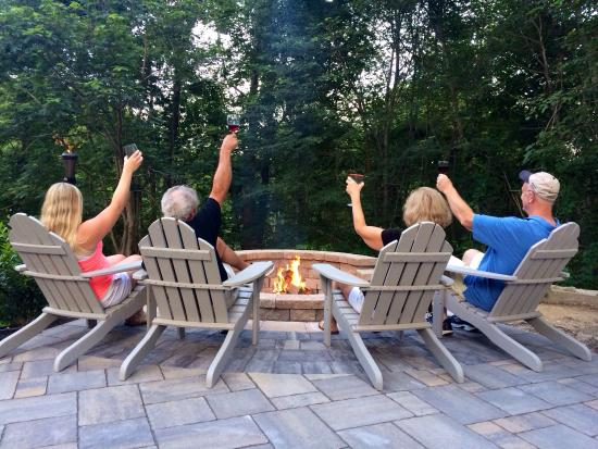 Enjoying a glass of wine by the fire pit.