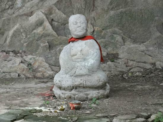 Qinhuangdao, Kina: Статуя забавная