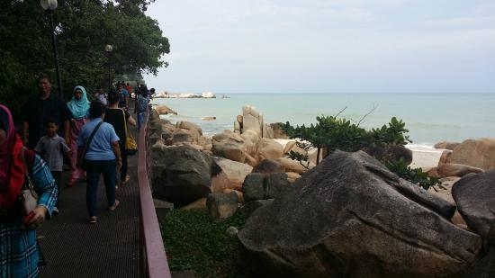 Walking over from Teluk Cempedak Beach to another scenic beach ...