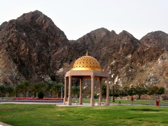 Al-Riyam Park: A gazebo in the park with dramatic mountains in background