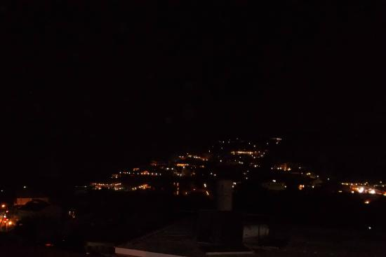 Tsaros Apartments: Night view from rooftop terrace